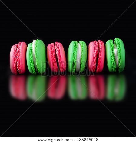 Colorful French Macarons on a black background