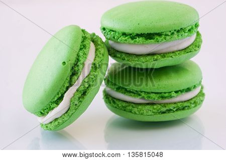 green French Macarons on a white background