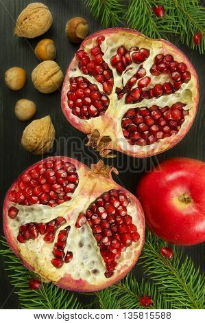 Fresh ripe garnet on wooden table. Top view. Christmas concept. Vintage style