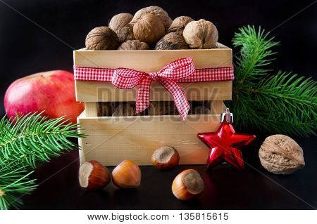 Wooden box with walnuts and hazelnuts. Christmas decoration