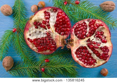 Fresh ripe garnet on wooden table. Top view. Christmas concept.
