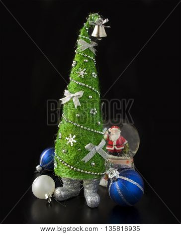 Creative Christmas tree on black background. Christmas design.