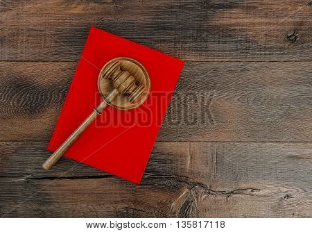 Judges Gavel with Soundboard and red Book. Hammer on rustic wooden background