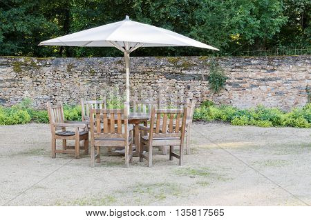 Garden furniture: patio set with a parasol