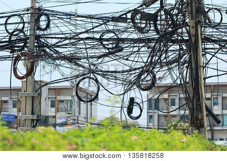 Tangled cables on a electricity post make bad image