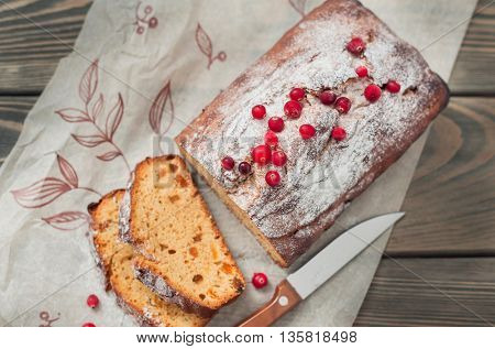 Homemade cake with dried apricots and raisins, decorated with cranberries.