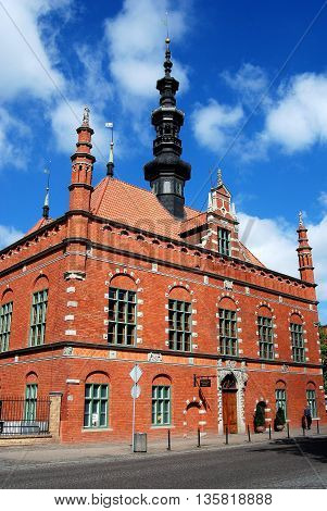 Gdansk Poland - May 28 2010: Renaissance red brick Ratusz town hall with ornamental steeple