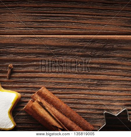 Gingerbread cookies hanging over wooden background. Closeup