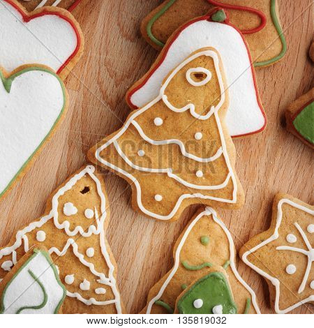 Christmas gingerbread cookies and fir tree on fabric background. Close up