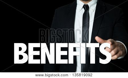 Business man pointing the text: Benefits