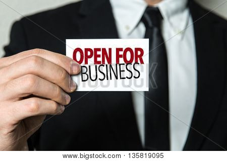 Business man holding a card with the text: Open for Business