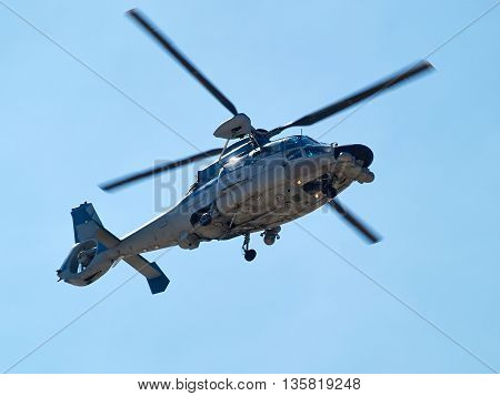 Rescue helicopter in action with clear blue sky background