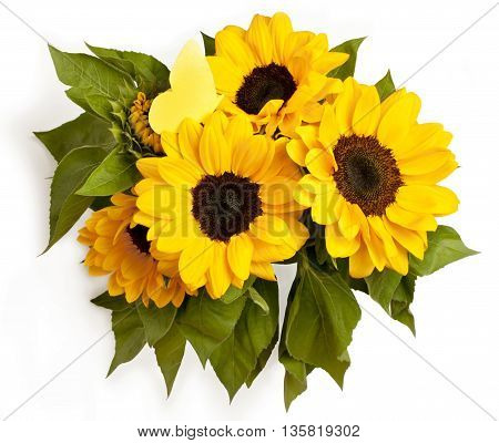 A photo of a bouquet of sunflowers with a paper butterfly shot from above on a white background; nature concept