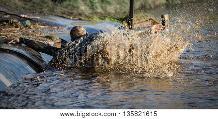 Deep muddy water with man slipping into the waterflooding foot group guy help iron man join land mono move movement mud muddy Objects people race run soil splash splashing sport sports stream s