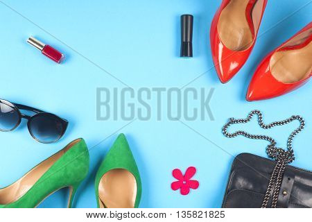 Women Clothing Set, Set Of Cool Stuff And Accessories On Light Blue Background. Top View.