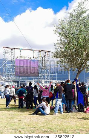 QUITO, ECUADOR - JULY 7, 2015: Big screen at pope Francisco mass, people far from him can see. Road inside mass.