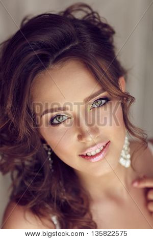 Portrait Of Beautiful Bride With Perfect Makeup And Hairstyle
