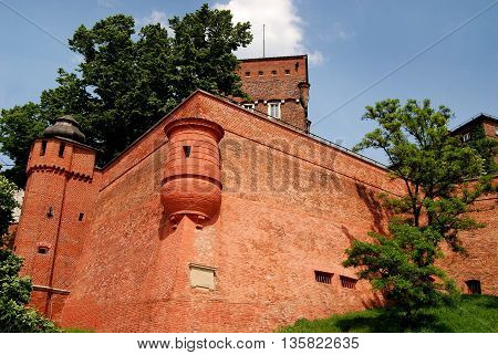 Krakow Poland - June 10 2010: Imposing bastion with small round watch tower on the medieval defensive Wawel Hill defensive walls