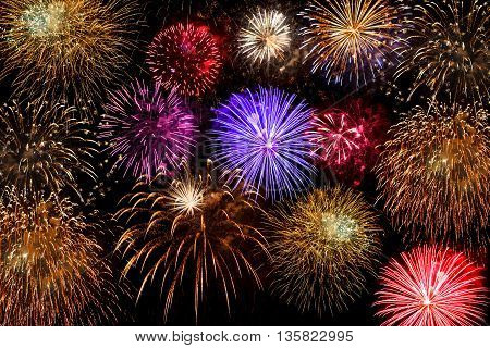 beautiful multi-colored fireworks against a night sky