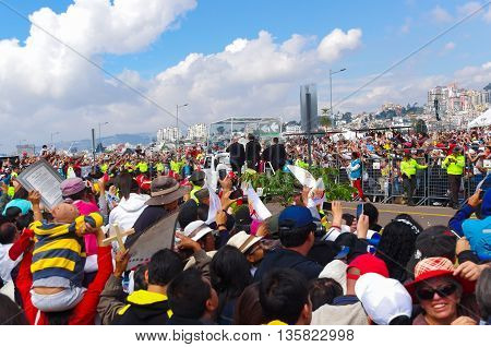QUITO, ECUADOR - JULY 7, 2015: Police guarding pope Francisco little round trip around huge mass, popemobile.