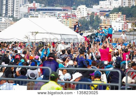 QUITO, ECUADOR - JULY 7, 2015: Pope Francisco making a little route around Ecuador mass, people trying to take him a photo.