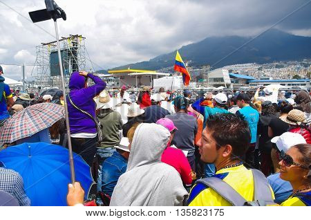QUITO, ECUADOR - JULY 7, 2015: A sunny day with lots of people waitting for pope Francisco, Ecuador flags between everyone.