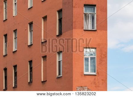 Several windows in a row and corner of facade of urban apartment building front view St. Petersburg Russia
