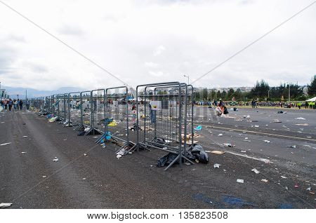 QUITO, ECUADOR - JULY 7, 2015: After pope Francisco mass, garbage in the place and metal mesh of the police.