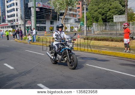 QUITO, ECUADOR - JULY 7, 2015: Traffic police with white uniform rolling in the city, guard of the pope.