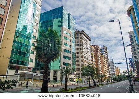 QUITO, ECUADOR - JULY 7, 2015: Commercial and bussines neighborhood in the north of the city, nice avenue with various buildings.