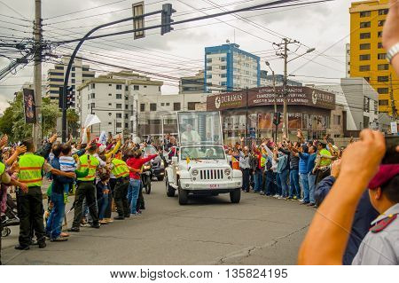 QUITO, ECUADOR - JULY 7, 2015: Pope Francisco arriving to Ecuador, people on the streets saying welcome, police on the sides.