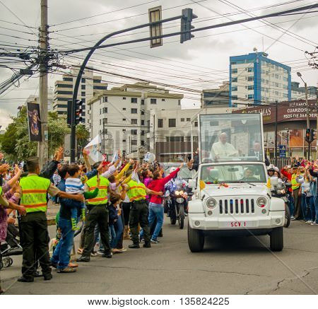 QUITO, ECUADOR - JULY 7, 2015: Very emocional and nice moment of pope Ecuador arriving to Ecuador, popemobile in white color.