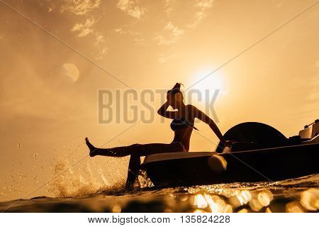 Girl On Paddle Boat With Sunlight Bokeh And Water Splash