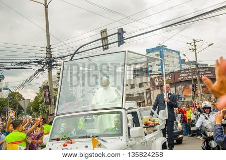 QUITO, ECUADOR - JULY 7, 2015: Pope Francisco crossing Quito city in his popemobile, security on the sides.