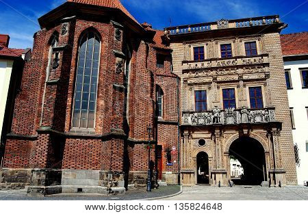 Bregz Poland - June 16 2010: 14th century gothic chapel and 16th century Palace of the Piasts (Dukes of Silesia) gateway adorned with Renaissance figures