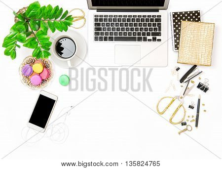 Office supplies and laptop. Business still life. Coffee and macaroon cookies. Creative workplace. Flat lay