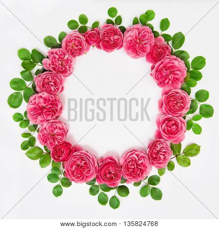 Roses with green leaves isolated on white background. Beautiful flower head wreath. Pink rose flowers