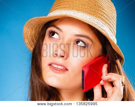 Technology and communication - teen girl talking on mobile phone smartphone lovely woman using cell phone on blue