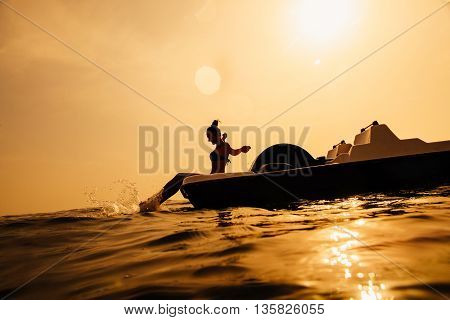 Girl On Paddle Boat Catamaran With Sunlight And Splash