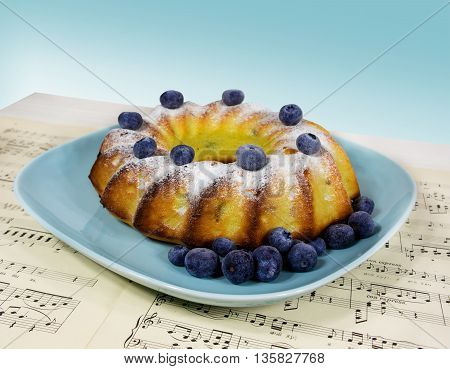 cake with blueberries on a blue plate