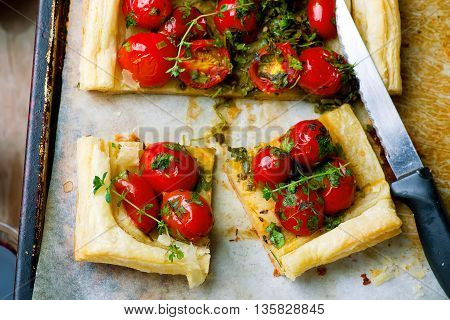 tart with cherry tomatoes and herbs. selective focus