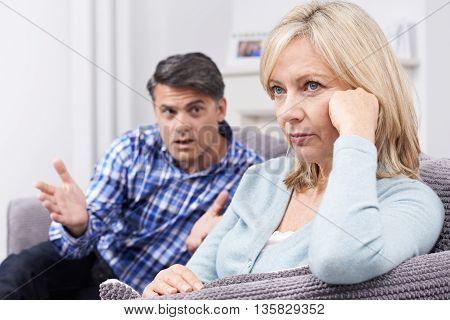 Unhappy Mature Couple Having Argument At Home