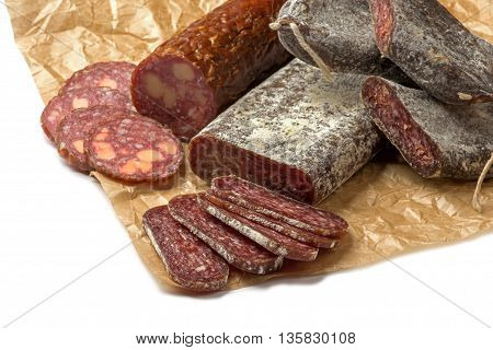 Close up Sliced flat sausage salami on paper