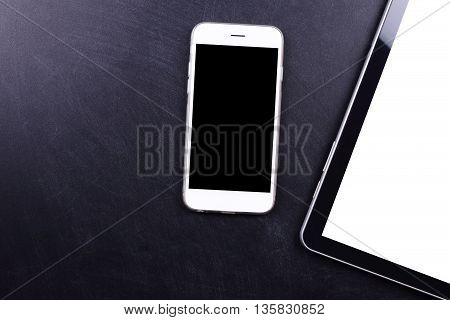 blank screen smartphone and tablet on black wooden