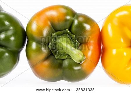 some vegetables of yellow and green pepper isolated on white background.