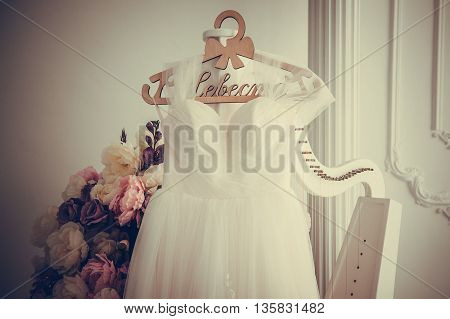 wedding dress hanging on racks, text means - Bride