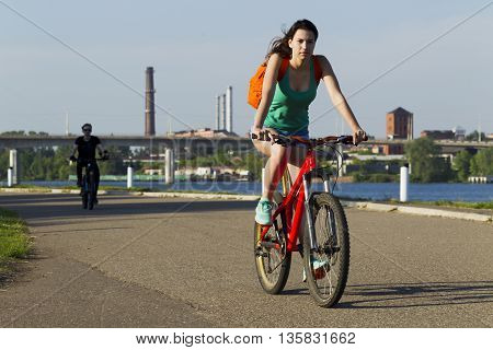 The Girl On A Bicycle Riding