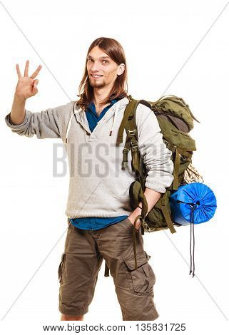Portrait of man tourist backpacker on trip showing ok gesture. Young guy hiker backpacking. Summer vacation travel. Isolated on white background.