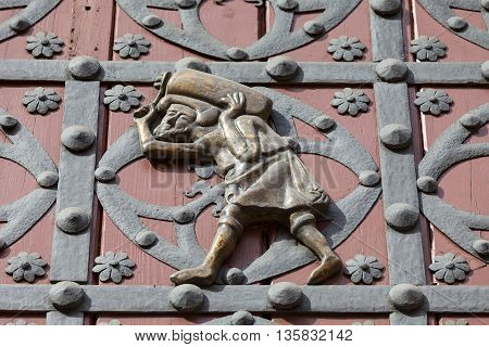 Porter on the doors of the main entrance to Catalan Gothic church Santa Maria del Mar Barcelona Spain