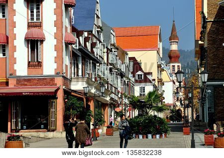 Bai Lu China - November 17 2013: View looking north on the principal street of the Sino-French village with its handsome French Alsatian style buildings